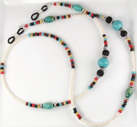 Made with semi-precious turquoise in oval and gemstone beads, dark wood beads, silver-plated spacers and Czech cherokee mix glass seed beads in green,