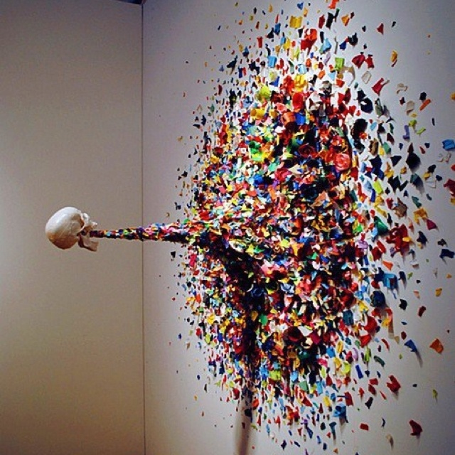 Confetti Death (2011) by Typoe.  Confetti Death, features a levatating skull forcefully puking out shards of spray can tops onto a wall. I see this as a metaphor of being bombarded by information to the point of sickness in the same way over eating can cause puking. The human brain isn't meant to be bombarded with information, it's unhealthy. I can see an idea in this.