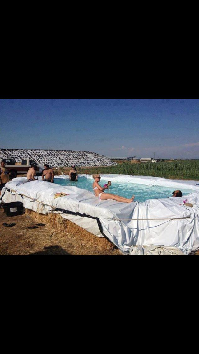 Redneck swimming pool bails of hay and a tarp texas - Redneck swimming pool with hay bales ...