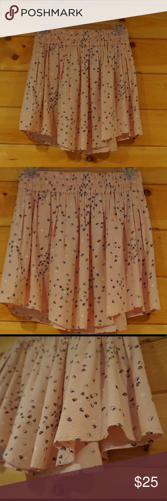 Light pink Skater skirt from Urban Outfitters Beautiful light pink Skater skirt with pockets from Urban Outfitters. Has only been worn gently. Features a cute design in gold and Navy, and also has pockets. Feel free to make an offer or bundle for discounts. 😊💕 Urban Outfitters Skirts Circle & Skater