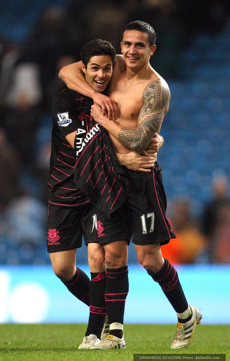 A little sweat won't stop the hugging (Cahill and Arteta)