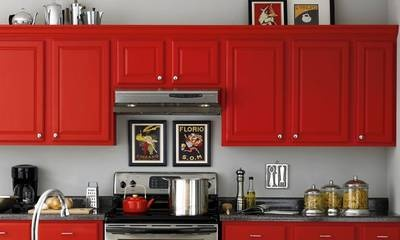 """What's the Kitchen's Look?    Even Dutch Boy calls this color scheme """"Depth Charge."""" And for good reason: this fire-hot red against the stone gray walls is mighty explosive.  Kitchen Paint Manufacturer(s)    Dutch Boy  Color Palette - Your Shopping List    Victory Red  Stonewall Jackson"""