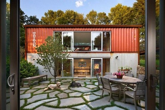 Simple two storey shipping container house in New Jersey, USA. Great mosaic external tiling