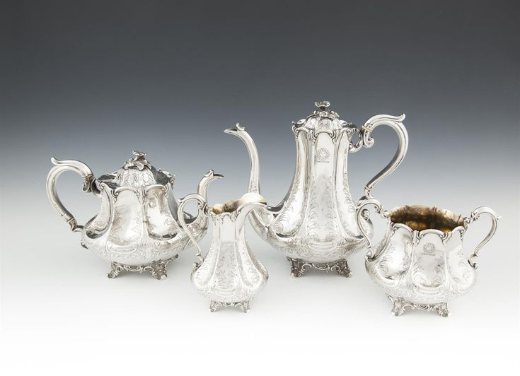 A FINE VICTORIAN FOUR PIECE TEA AND COFFEE SERVICE, Sheffield 1850, makers mark of Roberts & Slater (Samuel Roberts & Joseph Slater), comprising tea pot, coffee pot, sugar bowl and cream jug, each of concave panelled design tightly engraved with foliage scrolls, gilded interiors