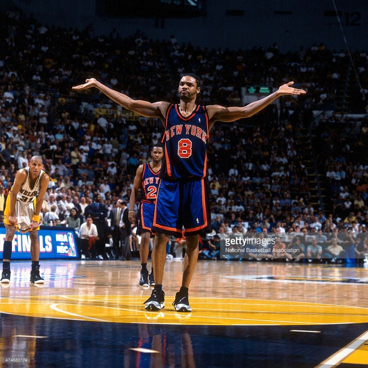 Latrell Sprewell #8 of the New York Knicks reacts to a play against the Indiana Pacers during a game in 1999 at Market Square Arena in Indianapolis, Indiana.