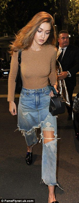 Gigi Hadid goes through three outfit changes during Milan Fashion Week day one…
