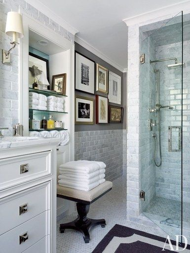 The master bath of a Kansas City, Missouri, home contains shower fittings by Restoration Hardware | archdigest.com