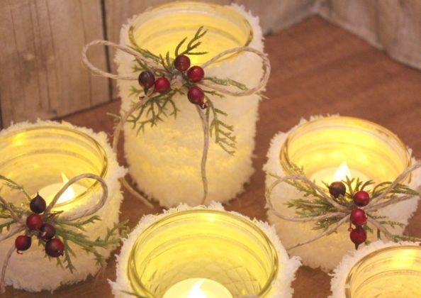 Fuzzy yarn wrapped around the outside transforms these jars into candle holders that appear as if they're covered in snow. How cozy is that? See more at Hometalk »