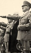 10.Hitler gives the Nazi salute at the 1936 Olympics in Berlin .