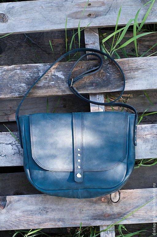 Women's bag is made of genuine leather. The bag fastens with a button. The front wall has a small zipper pocket. There is one big section and zippered pocket inside. Lining 100% US cotton. The long strap is adjustable, you can remove it inside and carry as a clutch bag. Made to order. I can make a bag of another color of leather. Size: approximately 30 x 20 x 8 cm Strap's width 2 cm #handmade #genuine #leather #clutch #handbag #deep #blue #menthol To order. 28November2015 price 82$USA