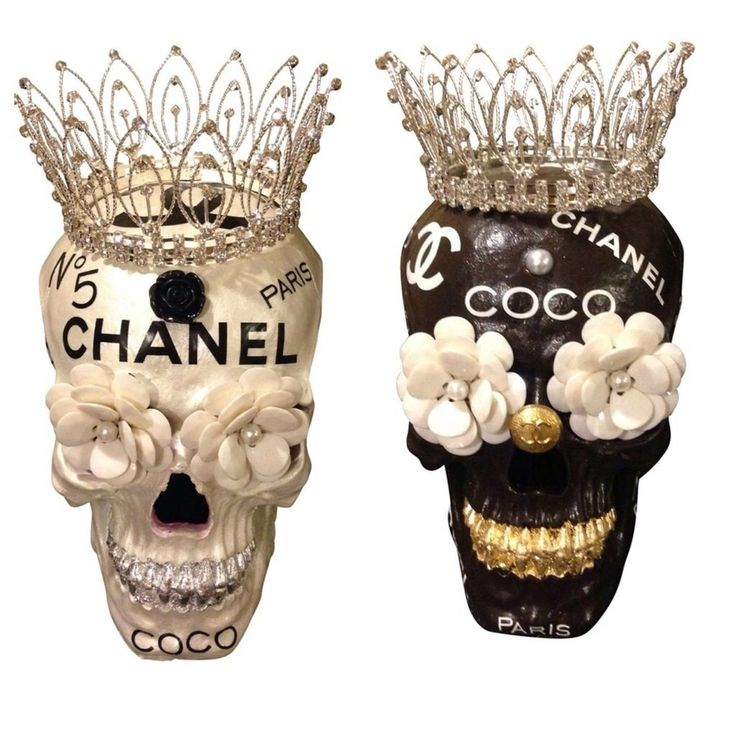 A Fun Whimsical And Unique Addition To Your Chanel Collection.This Funky Brown And Gold Leaf Skull Head Has The Finest In Craftmanship And Detail. Makes A Great Accent In Any RoomChocolate Brown Skull With White Logos. Gold Leaf Teeth, Gold Chanel Button Nose And Rhinestone Tiara Also Available in the Pearl and Silver Leaf Version, As Well As Black and White.Made to order