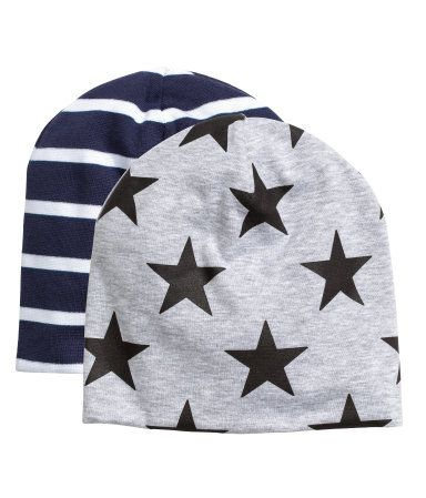 Dark blue/striped. Hats in double-layer, cotton-blend jersey.