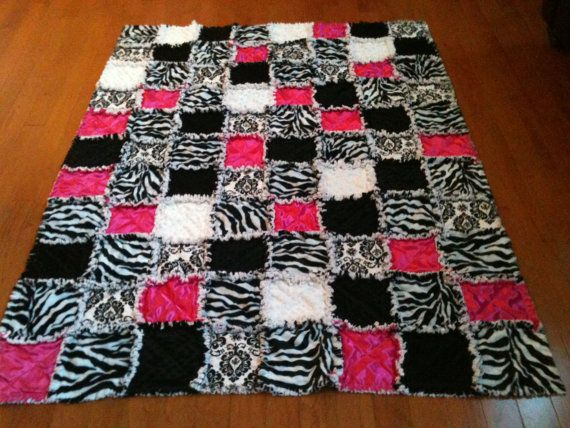 WILL SOMEBODY PLEASE MAKE ME THIS!!!!  ITS SO CUTE!!! BLACK, PINK WHITE, and ZEBRA!!!!!cute rag quilt