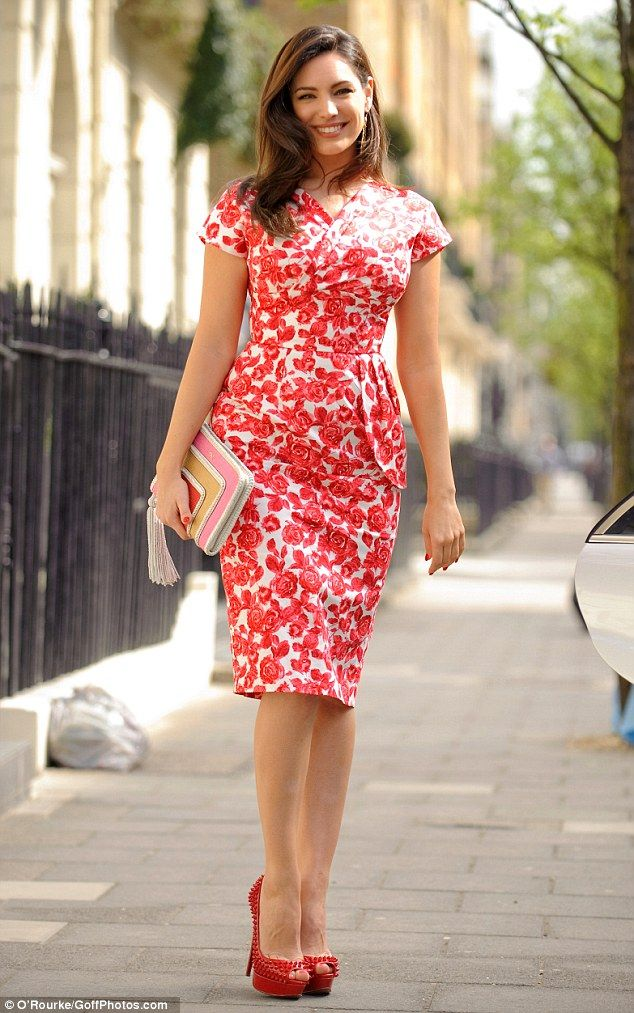 Head turner: Kelly Brook looked sensational in a floral dress which hugged her curves dramatically