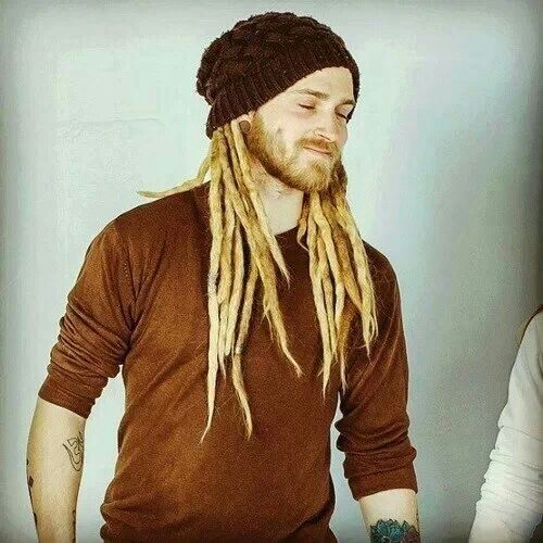 Another white dude with blonde dreadlocks, like Hunter Prindle. Hunter doesn't have facial hair (too itchy) & wouldn't b caught dead in that hat or shirt. I'll try to find someone wearing his Goth/BDSM look in a minute.