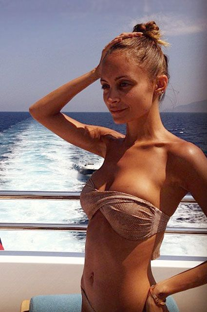 Nicole Richie leads anything but a simple life! The bikini-clad mother of two shared an Instagram pic on July 17, 2013 of her sunning on the back of what looks to be a yacht. Must be nice!