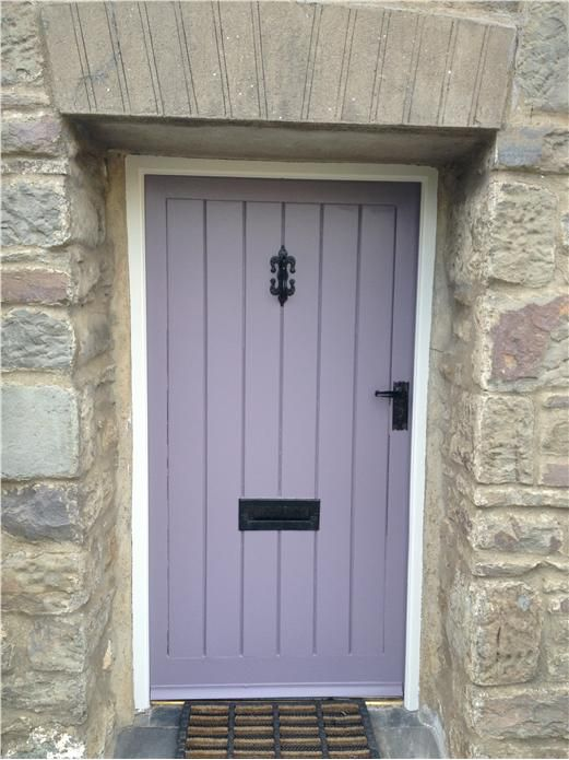 An inspirational image from Farrow and Ball I love the shades of mauve & blue in the stonework & the purple door.