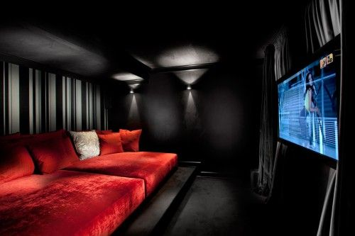 Who wouldn't want a cool, snazzy media room in their home?! Not sure if I would want it ALL black like this, but I do kinda like how it looks.