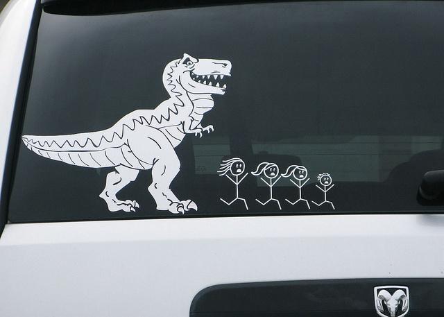 Dinosaur window sticker on a car