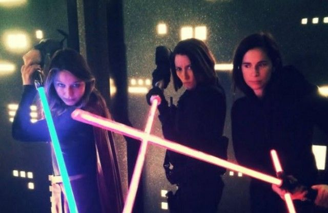 It appears that Supergirl has flown to a galaxy far, far away to acquire her very own lightsaber. Lexi Alexander, director of the latest Supergirl episode titled Truth, Justice, and the American Way, took to Twitter recently to share a behind-the-scenes photo of herself, series star Melissa Benoist, and co-star Chyler Leigh (Alex Danvers) brandishing their own fierce lightsabers. See Alexander's post below: We may have had some fun on that set @MelissaBenoist @chy_leigh #Supergirl pic.t