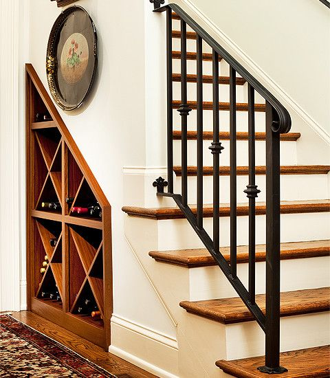 Sapele under staircase wine storage. Double bottle depth. Fabricated by Chris Wyse Photo by Dreier Photography