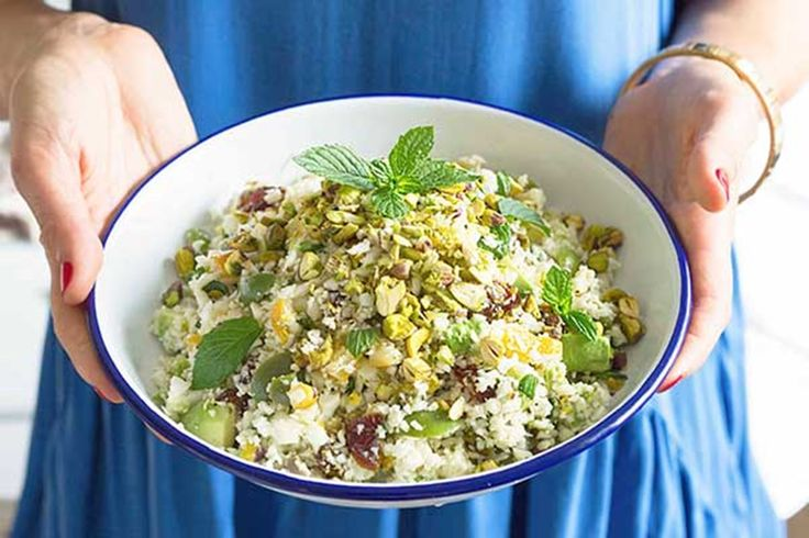 "If you've never tried raw cauliflower ""rice'', you'll be astounded how delicious, fresh and healthy it is. The dates, preserved lemon, Sicilian olives, herbs and pistachios create incredible bursts of flavour. This salad is perfect alongside meat and fish but is just as wonderful as a stand-alone dish. This recipe is from Kelly Gibney and it appears in Bronwyn Kan's book Whole: Recipes for Simple Wholefood Eating. Check out more from Kelly..."