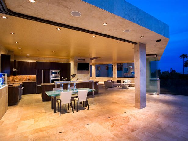 Although not technically an outdoor kitchen, as soon as the expansive pocket doors slide open, the entire home turns into a stunning alfresco experience ~ unreal!!