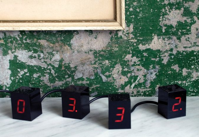 An alarm clock consisting of four 2 inch tall cubes. Each cube displays one glowing LED digit to make up the time display. Unlike static boxes usually associated with alarm clocks, this interactive collection of changing numbers can be arranged in any configuration.: Cubes Display, Alarm Clocks, Numbers Led, Clocks Consistency, Areawar Numbers, Glow Led, Clocks Design, Numbers Clocks, Led Clocks