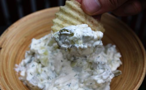 When I brought this pickle dip to a Labor Day cookout, and told fellow partygoers what it was, I watched their reactions: mildly disgusted at first, then curious. Most people who turned their noses up and walked away eventually came back to sneak a bite—or ten.