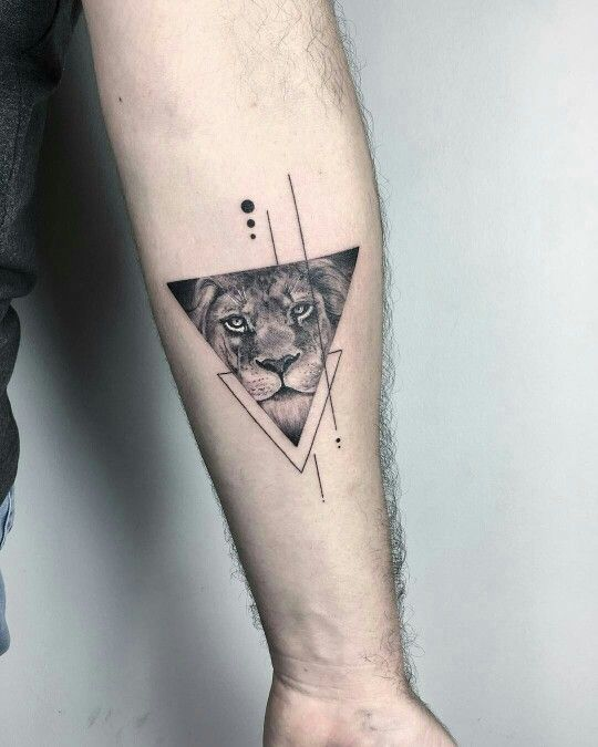 Eva KRBDK at Bang Bang NYC: triangle lion tattoo with simple geometric line and dot design