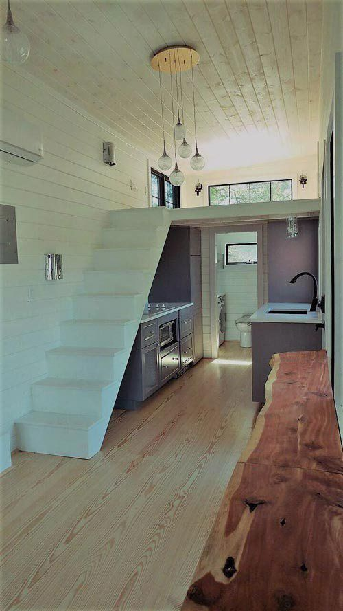 The No. 4 Cotton Burrow is a lovely tiny house built by Perch & Nest. The tiny house features a retractable screen porch and panoramic entry wall. The 36-foot custom tiny house was built using as many natural and chemical-free products as possible. At one end of the house is a large covered porch with … No. 4 Cotton Burrow by Perch & NestRead More »