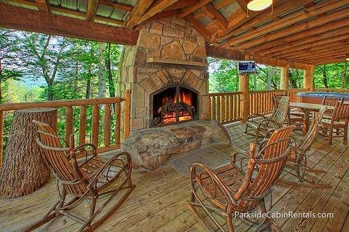 Smoky View is a 3 bedroom cabin with an outdoor fireplace!