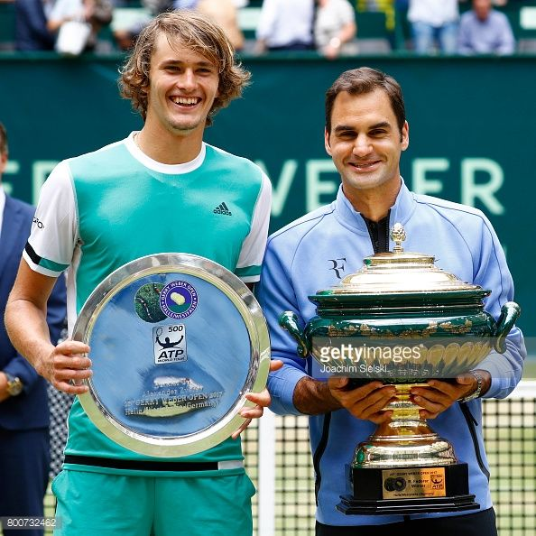 ALLE, GERMANY - JUNE 25: Alexander Zverev and Roger Federer after the men's singles match Roger Federer of Suiss against Alexander Zverev of Germany on Day 9 of the Gerry Weber Open 2017 at Gerry Weber Stadium on June 25, 2017 in Halle, Germany. (Photo by Joachim Sielski/Bongarts/Getty Images)
