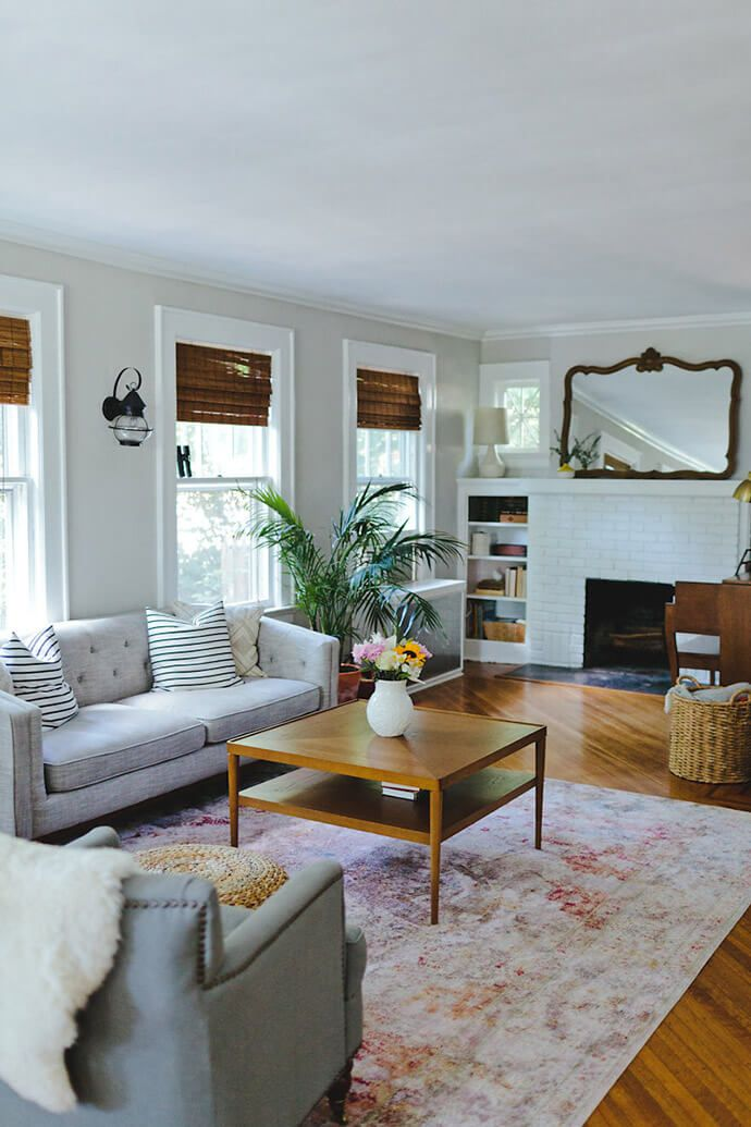 personal mood board - coffee table, sofas, floors, brick fireplace, bamboo shades, plants