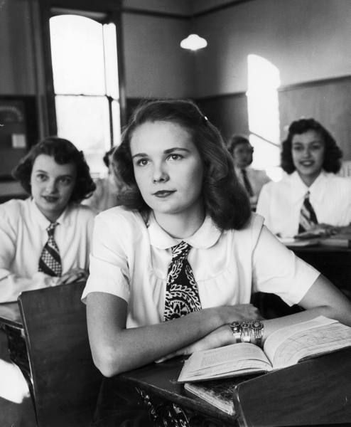 This 1948 Alfred Eisenstaedt photo shows high school girls in Des Moines, Iowa conforming to the local dress code of skirts, white blouses and ties.