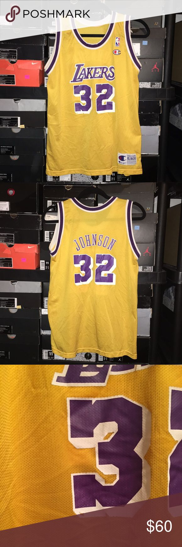 Vintage Champion Lakers Magic Johnson Jersey Vintage Champion Lakers Magic Johnson Jersey Kids XL 18-20. Small imperfection on front noted in 3rd photo. Jersey is in great condition. Champion Shirts & Tops Tank Tops