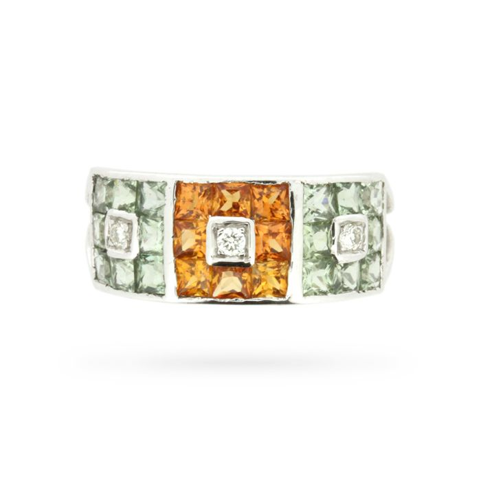 This captivating multicoloured dress ring showcases 2.51 carats of fancy colour blue-green, and orange princess cut sapphires! At centre, eight vibrant orange coloured sapphires are set edge to edge, forming a square frame around a round brilliant cut white diamond, which has been set within a square bezel. This composition is mirrored in light blue-green coloured sapphires to either …