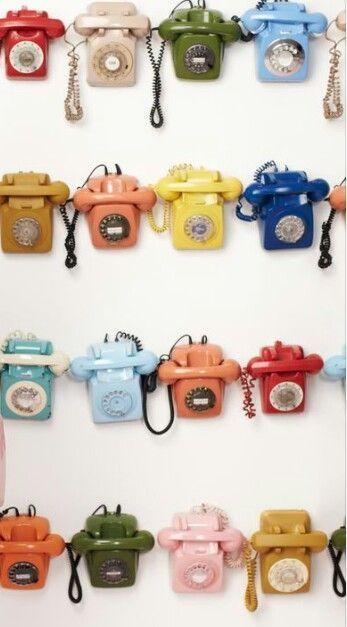 Rainbow array of Mid Century Modern telephones - old school!