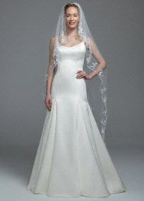 """Beaded edge single tier cathedral veil with scattered beaded flower applique.  One tier veil with beaded detail. Dimensions: 72""""W x 108""""L. Angel cut. Available in Ivory.  Imported."""