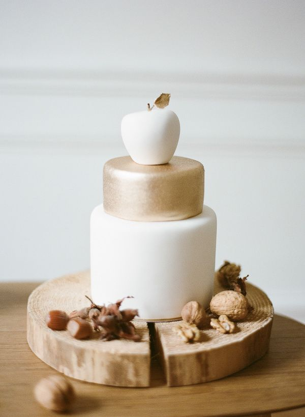 Gold and white cake. How cute is the apple topper?