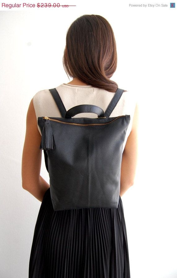 Beautiful BLACK leather backpack is made from best quality Italian leather.    Delicate & Elegant Black leather backpack in the perfect size