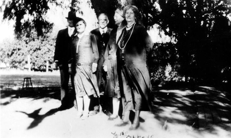 Original photo of members of the Maley family standing in what is now the front garden of the museum.