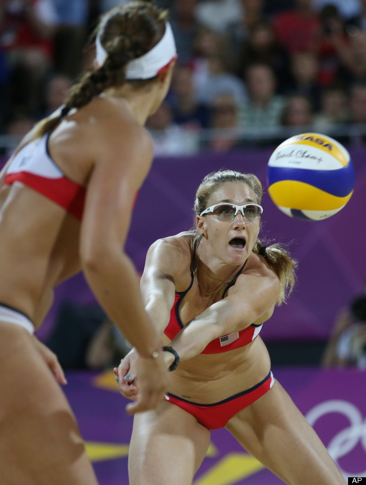 United States' Kerri Walsh Jennings, right, lsets a ball for Misty May-Treanor, left, during the women's gold medal beach volleyball match against the other US team at the 2012 Summer Olympics, Wednesday, Aug. 8, 2012, in London.