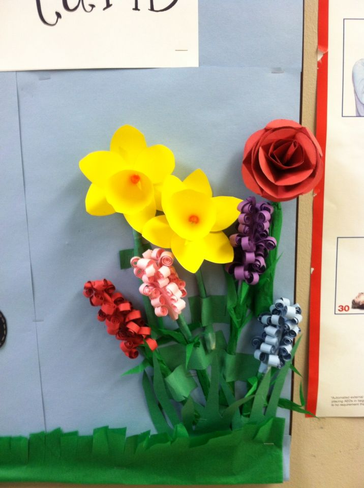 Paper flowers on my March bulletin board at the nursing home. paper daffodils paper rose and paper hyacinths.