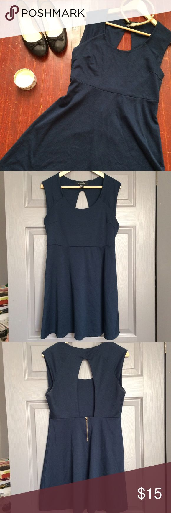 Forever21 Open Back Navy Skater Dress Cute & comfortable Forever21 knit skater dress. Open keyhole back, scoop neck, short zip at waist. Good condition with some pilling and mild discoloration under arms, pictured. Good quality knit that skims curves and is super flattering. Forever 21 Dresses Backless