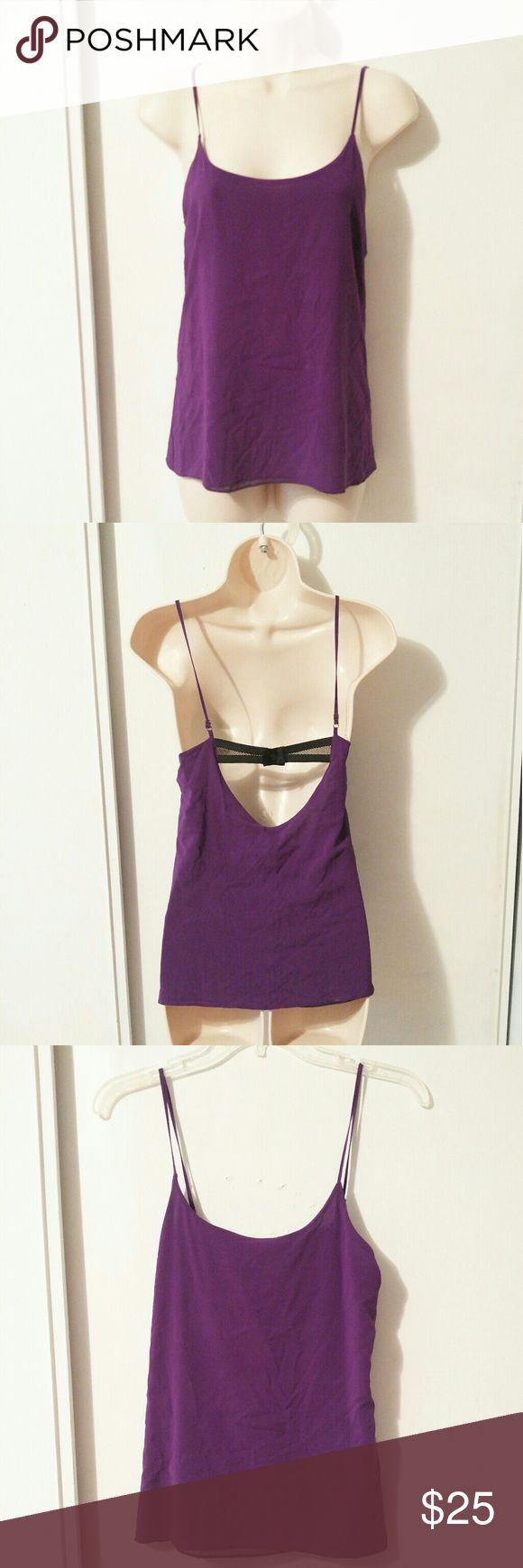 Alice + Olivia purple cami tank top BRAND: Alice + Olivia  SIZE: xs  FLAW: minor discoloration   COLOR: purple and black  DESCRIPTION: Alice + Olivia purple camisole top with black snap button strap. There are some minor discoloration marks. It's an amazing cami. Would look great with a black moto jacket and chunky boots.   Use #bishoujo to sort for your size. Please note I do have several pets, but all items will be washed before shipping  #aliceandolivia #aliceandoliviacami…