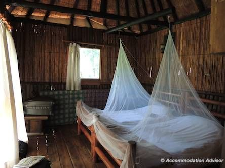 Thalu has a double and a twin bedroom with glass windows and a LATCHABLE door! Bring mozzie nets or you will get bitten!