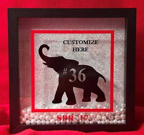 This Elephant Shadow Box will definitely make a statement!!!! This beauty will be a unique addition to your decor, great for your home or office. Perfect for you or as a gift. This shadow box comes in black; with or without pearl accents against a glittery silver background. The frame