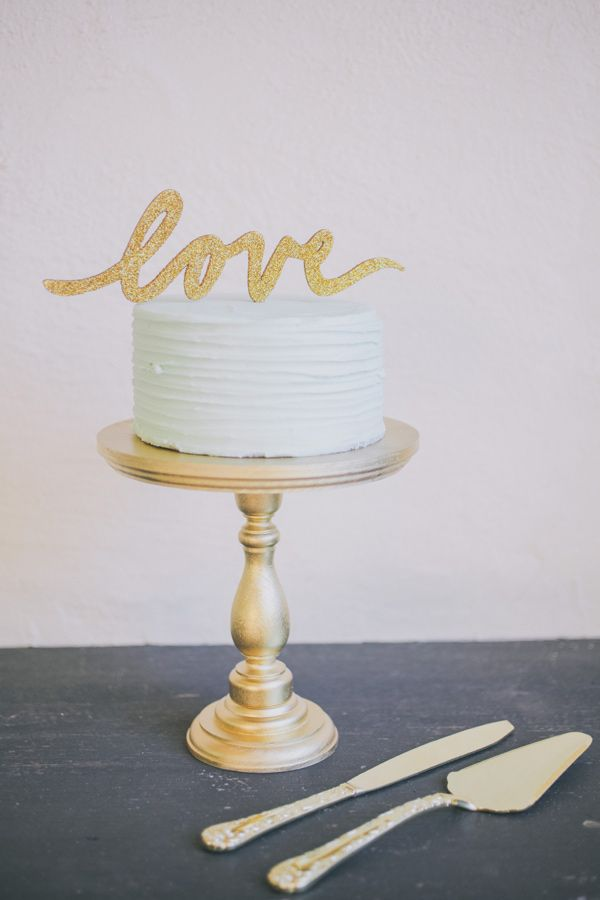 love cake topper, photo by Edyta Szyszlo http://ruffledblog.com/allied-arts-guild-wedding #weddingcake #cakes