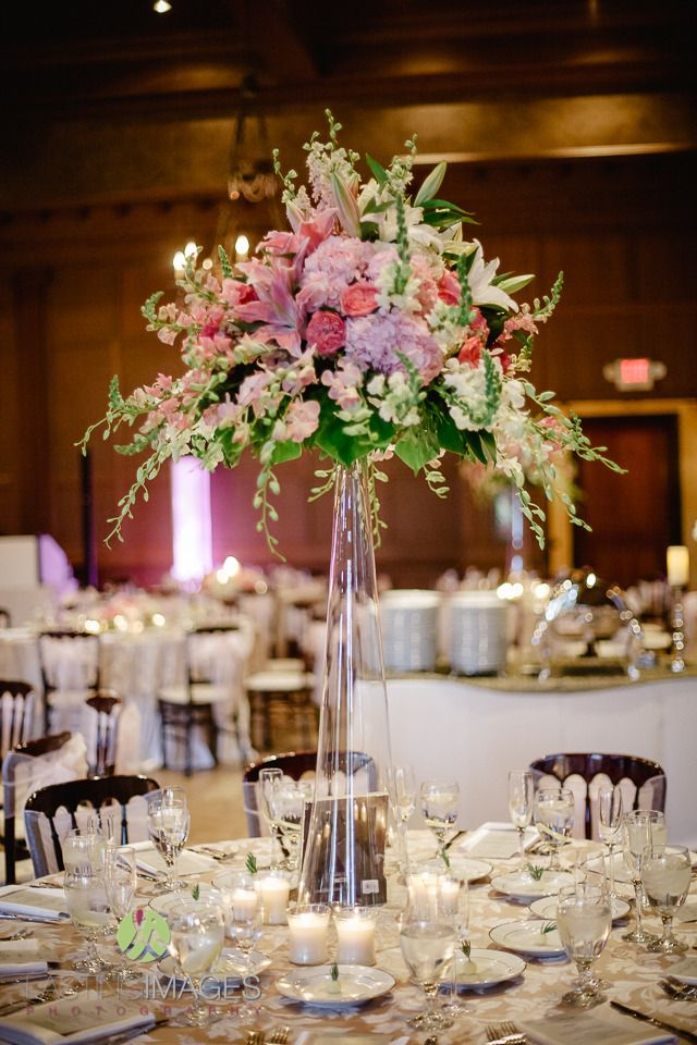 Tall glass cylinder centerpiece with pink hydrangea dark